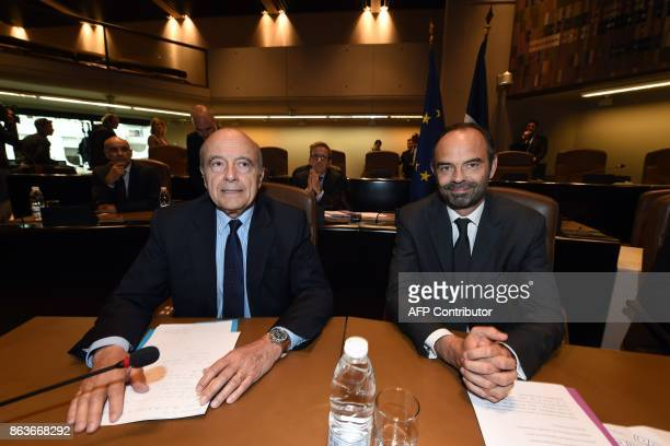 French Prime Minister Edouard Philippe sits with former Prime Minister and current Mayor of Bordeaux Alain Juppe as they meet agglomeration's...