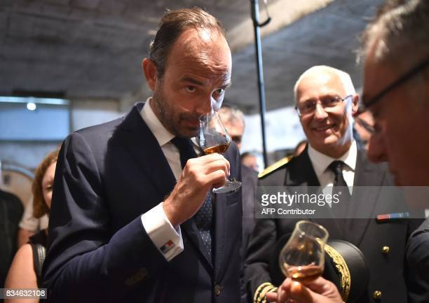 French Prime Minister Edouard Philippe smells a glass of armagnac during his visit to Domaine du Grand Comté in Roquelaure south western France on...