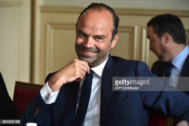 French Prime Minister Edouard Philippe smiles as he attends a meeting with professionals from the agricultural sector at the prefecture of the Gers...
