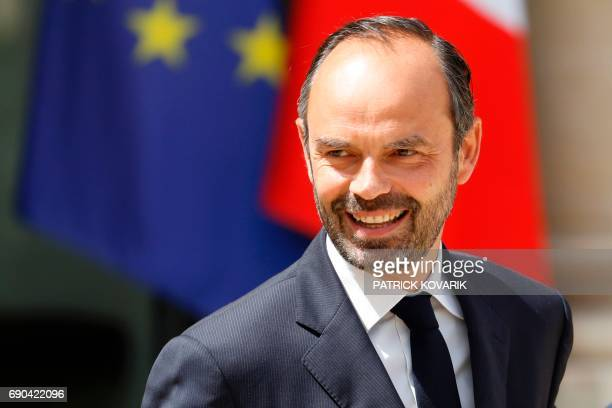 French Prime Minister Edouard Philippe smiles as he leaves a cabinet meeting on May 31 2017 at the Elysee Palace in Paris / AFP PHOTO / Patrick...