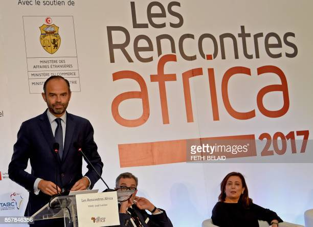 French Prime Minister Edouard Philippe speaks as Utica President and former Nobel prize winner Wided Bouchamaoui listens on during a FranceAfrica...