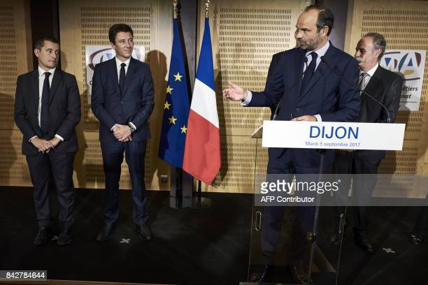 French Prime Minister Edouard Philippe speaks next to French Minister of Public Action and Accounts Gerald Darmanin and French Junior Minister for...