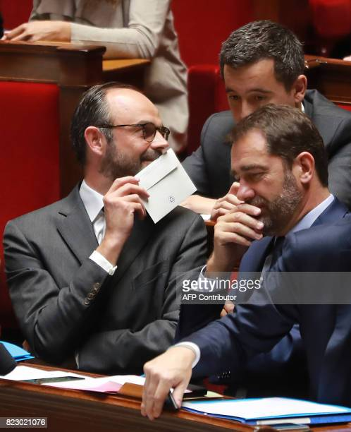 French Prime Minister Edouard Philippe speaks to French Minister of Public Action and Accounts Gerald Darmanin and French Junior Minister for the...