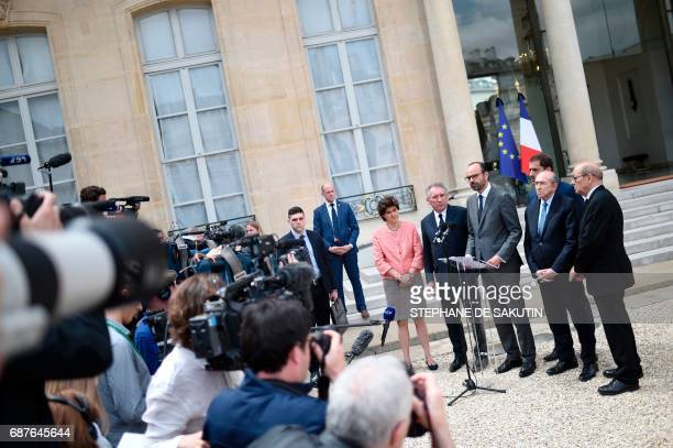 French Prime Minister Edouard Philippe speaks to journalists flanked by French Minister of the Armed Forces Sylvie Goulard French Minister of Justice...