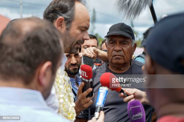 French Prime Minister Edouard Philippe speaks to local residents gathered for a demonstration against oil pollution in the town of We on Lifou Island...