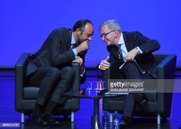 French Prime Minister Edouard Philippe speaks to the President of the Regional Council of ValdeLoire region Francois Bonneau during the opening of...