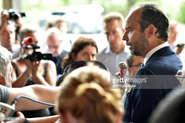 French Prime Minister Edouard Philippe speaks to the press during his visit to Domaine du Grand Comté in Roquelaure south western France on August 18...