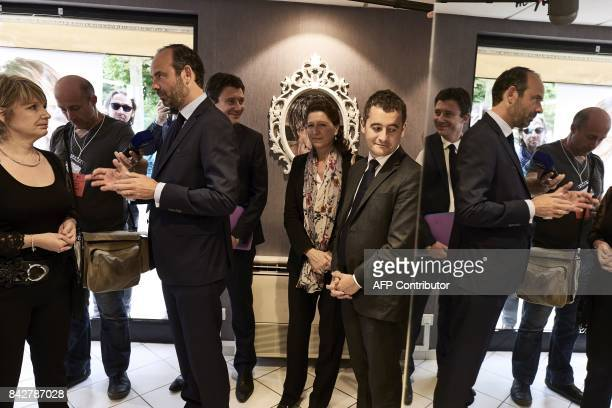 French Prime Minister Edouard Philippe speaks with a hairdresser next to French Minister of Public Action and Accounts Gerald Darmanin and French...