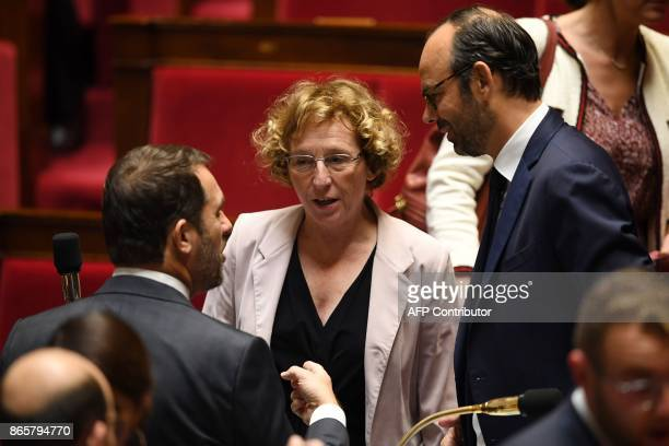 French Prime Minister Edouard Philippe speaks with French Junior Minister for the Relations with Parliament and Government Spokesperson Christophe...