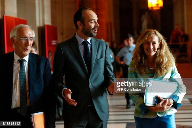 French Prime Minister Edouard Philippe speaks with French Justice Minister Nicole Belloubet during a visit to the Tribunal de Grande Instance in...