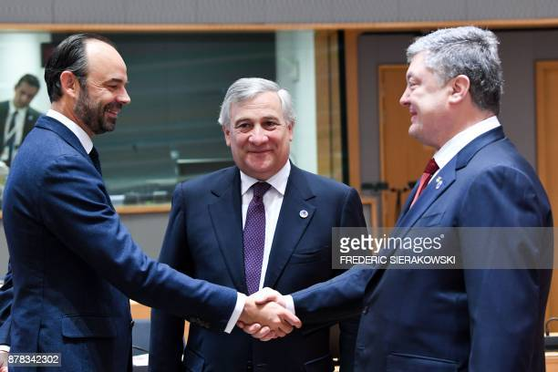 French Prime Minister Edouard Philippe stands next to European Parliament President Antonio Tajani as he shakes hands with Ukraine's President Petro...