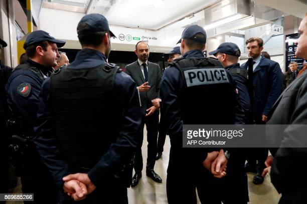 French Prime Minister Edouard Philippe talks with police forces at the Gare du Nord RER urban train station in Paris on November 3 as part of the...