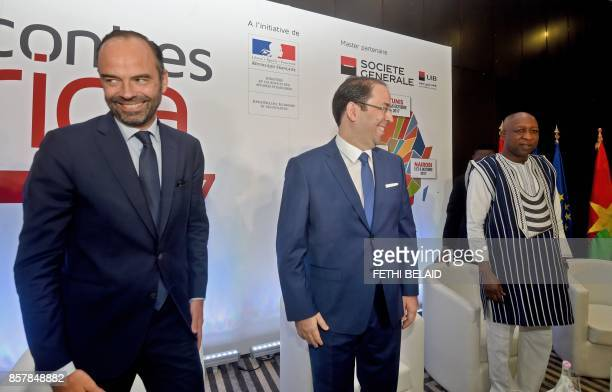 French Prime Minister Edouard Philippe Tunisian Prime Minister Youssef Chahed and Burkina Faso Prime Minister Paul Kaba Thieba take part in a...