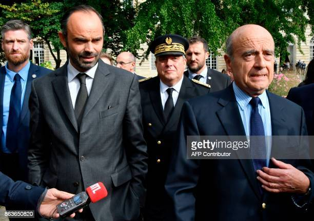 French Prime Minister Edouard Philippe walks with former Prime Minister and current Mayor of Bordeaux Alain Juppe as they proceed towards The Hotel...
