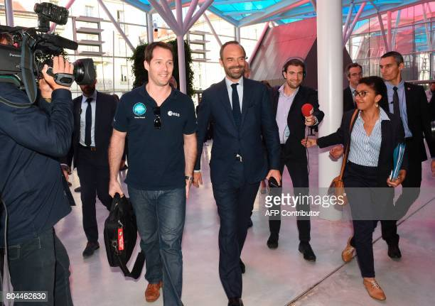 French Prime Minister Edouard Philippe welcomes French astronaut Thomas Pesquet prior to attend a seminar in Nancy on June 30 2017 / AFP PHOTO /...