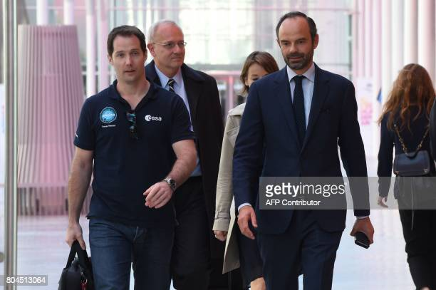 French Prime Minister Edouard Philippe welcomes French astronaut Thomas Pesquet prior to attend a government seminar in Nancy on June 30 2017 / AFP...