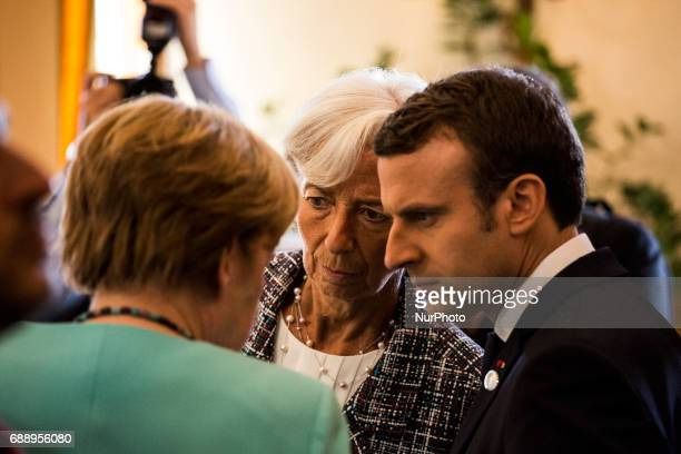 French Prime Minister Emmanuel Macron head of the International Monetary Fund Christine Lagarde and German Chancellor Angela Merkel talk during the...