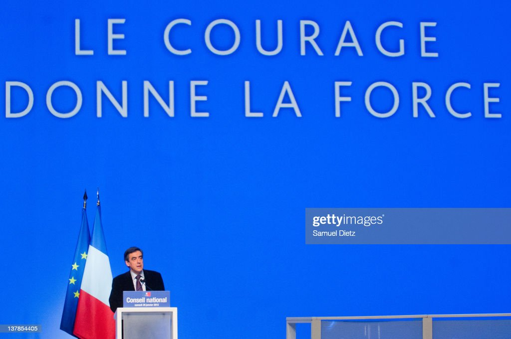 French Prime Minister <a gi-track='captionPersonalityLinkClicked' href=/galleries/search?phrase=Francois+Fillon&family=editorial&specificpeople=835870 ng-click='$event.stopPropagation()'>Francois Fillon</a> addresses the audience during UMP National Convention at Parc des Expositions Porte de Versailles on January 28, 2012 in Paris, France. The National Convention was held to validate formally the UMP program that will be presented by their candidate in the upcoming Presidential elections that will take place in May 2012.