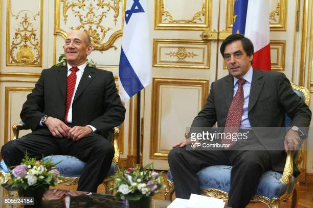 French Prime Minister Francois Fillon and Israeli Prime minister Ehud Olmert pose before a meeting at the Hotel Matignon the official residence of...