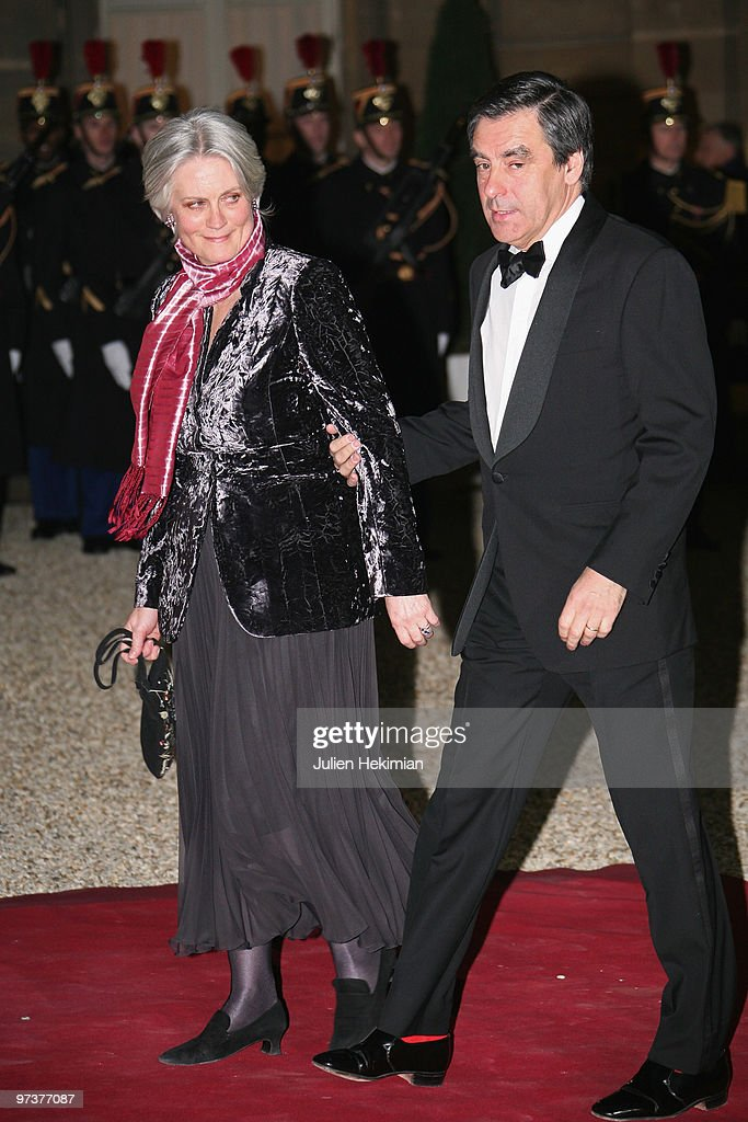 French Prime Minister Francois Fillon arrives with wife Penelope to attend a state dinner honouring visiting Russian President Dmitry Medvedev at Elysee Palace on March 2, 2010 in Paris, France.