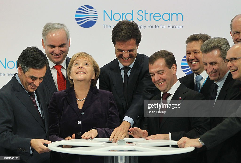 French Prime Minister Francois Fillon, German Chancellor <a gi-track='captionPersonalityLinkClicked' href=/galleries/search?phrase=Angela+Merkel&family=editorial&specificpeople=202161 ng-click='$event.stopPropagation()'>Angela Merkel</a>, Dutch Prime Minister <a gi-track='captionPersonalityLinkClicked' href=/galleries/search?phrase=Mark+Rutte&family=editorial&specificpeople=4509362 ng-click='$event.stopPropagation()'>Mark Rutte</a>, Russian President Dmitry Medvedev and European Union Energy Commissioner Guenther Oettinger turn a wheel to symbolically start the flow of gas through the Nord Stream Baltic Sea gas pipeline at a cemerony on November 8, 2011 in Lubmin, Germany. The Nord Stream pipeline runs through the Baltic Sea and will supply Europe with natural gas from Russia.