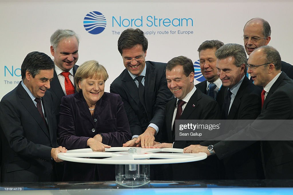 French Prime Minister Francois Fillon, German Chancellor Angela Merkel, Dutch Prime Minister <a gi-track='captionPersonalityLinkClicked' href=/galleries/search?phrase=Mark+Rutte&family=editorial&specificpeople=4509362 ng-click='$event.stopPropagation()'>Mark Rutte</a>, Russian President Dmitry Medvedev and European Union Energy Commissioner Guenther Oettinger turn a wheel to symbolically start the flow of gas through the Nord Stream Baltic Sea gas pipeline at a cemerony on November 8, 2011 in Lubmin, Germany. The Nord Stream pipeline runs through the Baltic Sea and will supply Europe with natural gas from Russia.