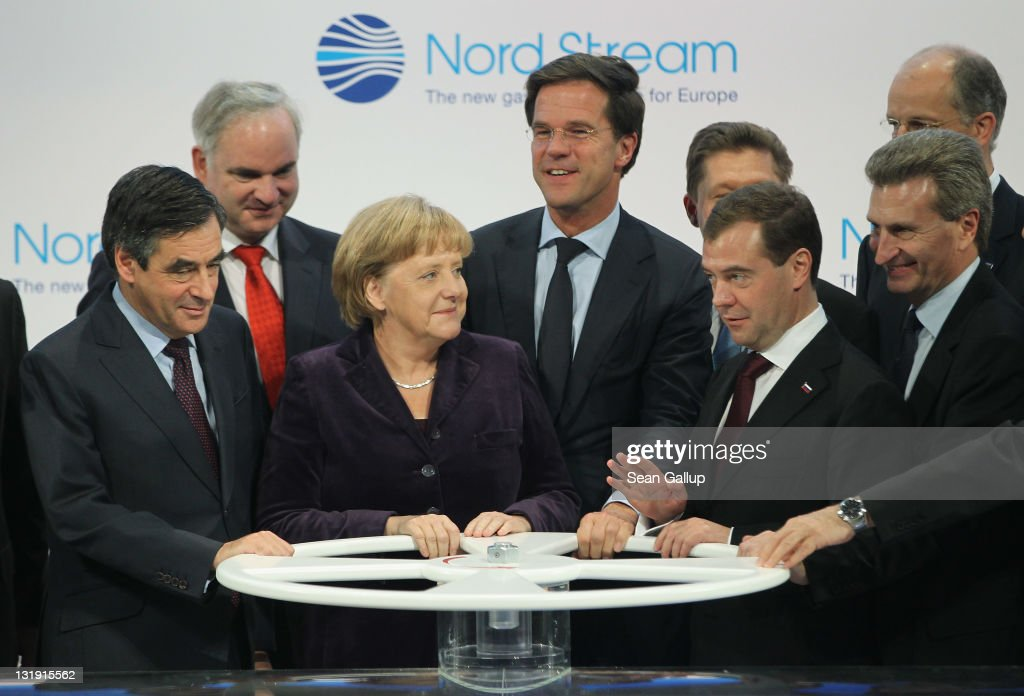 French Prime Minister Francois Fillon, German Chancellor Angela Merkel, Dutch Prime Minister <a gi-track='captionPersonalityLinkClicked' href=/galleries/search?phrase=Mark+Rutte&family=editorial&specificpeople=4509362 ng-click='$event.stopPropagation()'>Mark Rutte</a>, Russian President Dmitry Medvedev and European Union Energy Commissioner Guenther Oettinger prepare to turn a wheel to symbolically start the flow of gas through the Nord Stream Baltic Sea gas pipeline at a cemerony on November 8, 2011 in Lubmin, Germany. The Nord Stream pipeline runs through the Baltic Sea and will supply Europe with natural gas from Russia.