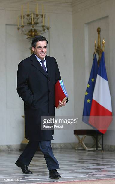 French Prime Minister Francois Fillon leaves the weekly cabinet meeting at Elysee Palace on February 9 2011 in Paris France French President Sarkozy...