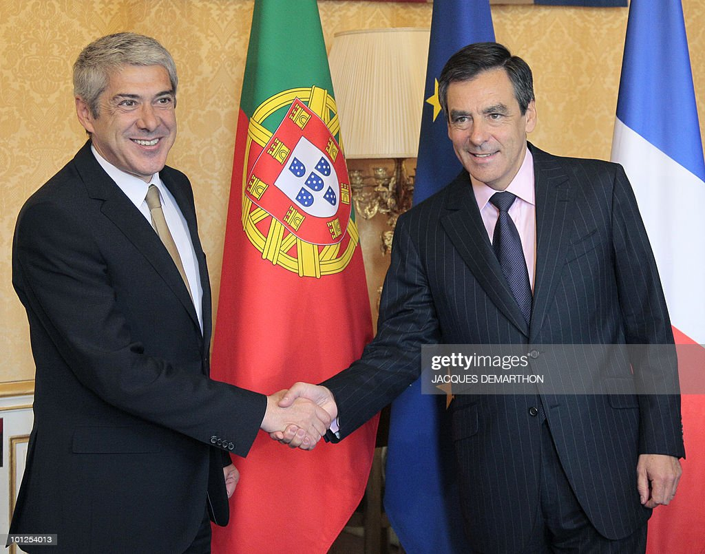 French Prime Minister Francois Fillon (R) shakes hands with his Portuguese counterpart Jose Socrates upon his arrival for a meeting to discuss a number of economic issues on May 7, 2010 in Paris. Socrates said today he was 'worried' about the stability of the euro, ahead of a major summit on the debt crisis rattling the single currency zone.