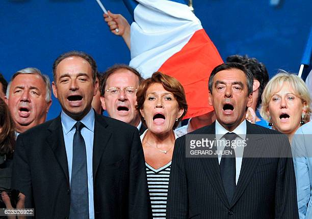 French Prime minister Francois Fillon sings the Marseillaise French national anthem with French right wing UMP party general secretary JeanFrançois...