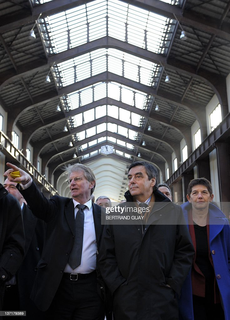 French Prime minister Francois Fillon (C) visits the project of the 'Cité du Cinéma' (City of the Cinema) with Seine-Saint-Denis deputy Patrick Braouzec (L) and Saint-Ouen mayor Jacqueline Rouillon as part of the 'Grand Paris' (the'Greater Paris') project on January 16, 2012 in Saint-Denis, outside Paris. The French National Assembly on December 1, 2009 passed a bill setting in motion a master plan to create a 'Greater Paris' with a new 40-station metro line connecting the capital to its gritty suburbs. The legislation outlining the 21-billion-euro (32-billion-dollar) infrastructure project was adopted by a vote of 299 to 216 and is due to go before the Senate for final approval in February. AFP PHOTO BERTRAND GUAY