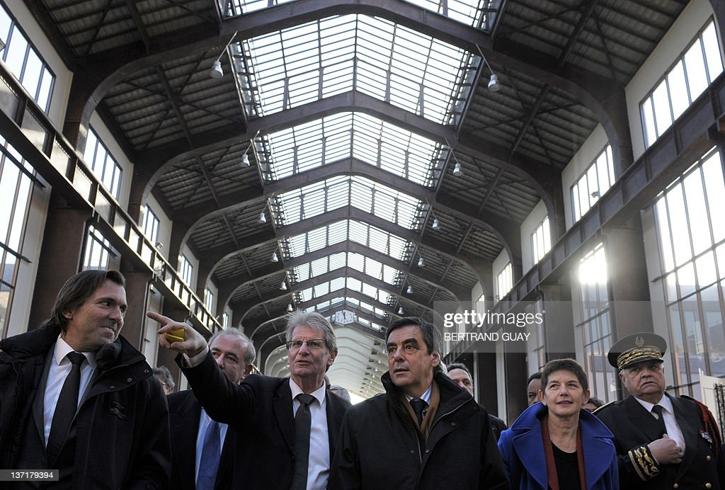 French Prime minister Francois Fillon (C) visits the project of the 'Cité du Cinéma' (City of the Cinema) with Seine-Saint-Denis deputy Patrick Braouzec (2ndL), Saint-Ouen mayor Jacqueline Rouillon (2ndR), Seine-Saint-Denis' prefect Christian Lambert (R) and publicist Christophe Lambert (L) as part of the 'Grand Paris' (the'Greater Paris') project on January 16, 2012 in Saint-Denis, outside Paris. The French National Assembly on December 1, 2009 passed a bill setting in motion a master plan to create a 'Greater Paris' with a new 40-station metro line connecting the capital to its gritty suburbs. The legislation outlining the 21-billion-euro (32-billion-dollar) infrastructure project was adopted by a vote of 299 to 216 and is due to go before the Senate for final approval in February. AFP PHOTO BERTRAND GUAY