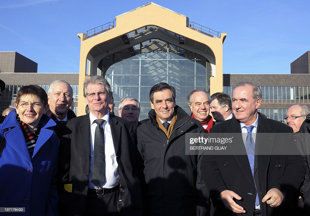 French Prime minister Francois Fillon (C) visits the project of the 'Cité du Cinéma' (City of the Cinema) with Seine-Saint-Denis deputy Patrick Braouzec (3rdL), Saint-Ouen mayor Jacqueline Rouillon (L), Urban Development Minister Maurice Leroy (R) and Culture Minister Frederic Mitterrand (2ndR) as part of the 'Grand Paris' (the'Greater Paris') project on January 16, 2012 in Saint-Denis, outside Paris. The French National Assembly on December 1, 2009 passed a bill setting in motion a master plan to create a 'Greater Paris' with a new 40-station metro line connecting the capital to its gritty suburbs. The legislation outlining the 21-billion-euro (32-billion-dollar) infrastructure project was adopted by a vote of 299 to 216 and is due to go before the Senate for final approval in February.