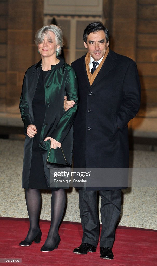 French Prime minister François Fillon and his wife Penelope pose as they arrive to the State Dinner At Elysee Palace Honouring South African President Jacob Zuma at Elysee Palace on March 2, 2011 in Paris, France.