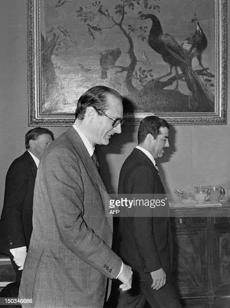 French Prime minister Jacques Chirac walks 03 March 1975 in Hotel Matignon in Paris alongside with Iraqi VicePresident Saddam Hussein As Premier...