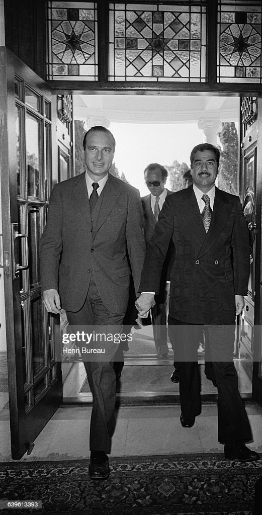 French Prime Minister <a gi-track='captionPersonalityLinkClicked' href=/galleries/search?phrase=Jacques+Chirac&family=editorial&specificpeople=165237 ng-click='$event.stopPropagation()'>Jacques Chirac</a> with Iraqi Vice President <a gi-track='captionPersonalityLinkClicked' href=/galleries/search?phrase=Saddam+Hussein&family=editorial&specificpeople=121553 ng-click='$event.stopPropagation()'>Saddam Hussein</a> (R) during the last day of an official visit to Iraq. Chirac held the meeting with Iraqi officials to sign an agreement placing France at the head of commercial exchanges.
