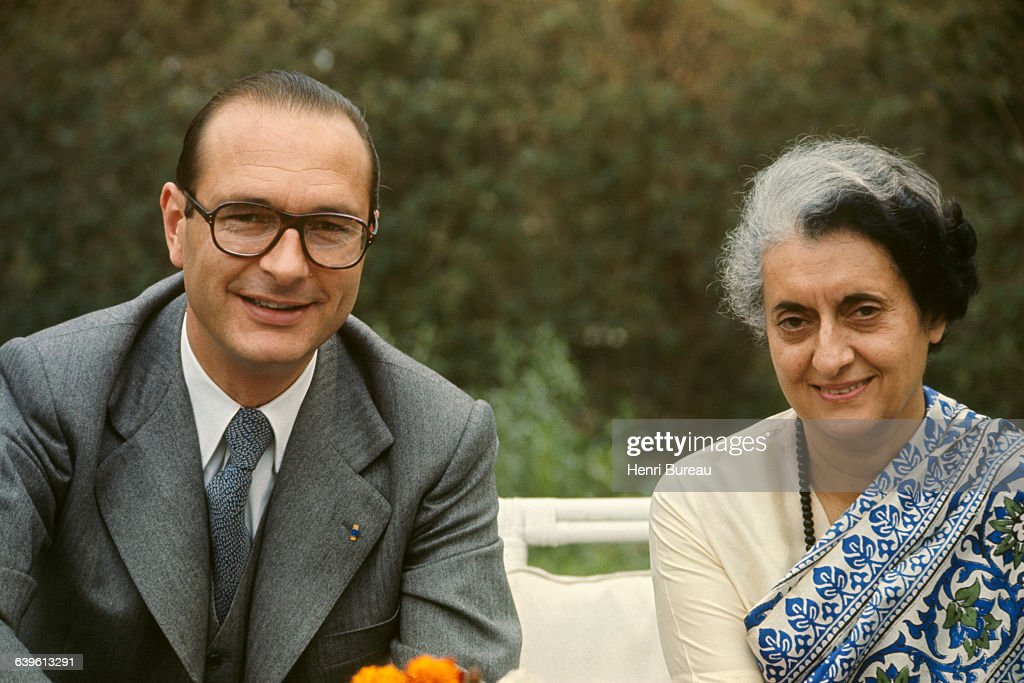 French Prime Minister Jacques Chirac with wife Bernadette (R) are welcomed by Indian Prime Minister Indira Gandhi in the garden of the Fench embassy, in New Delhi.