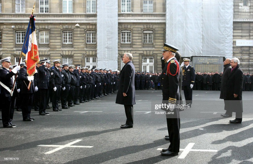 French Prime Minister Jean Marc Ayrault during the funerals of two French policemen killed in a Paris car chase, at Prefecture de Police on February 26, 2013 in Paris, France. The two officers were killed after their vehicle collided with a car they were chasing on the peripherique, the capital's main ring road, on Thursday February 21.