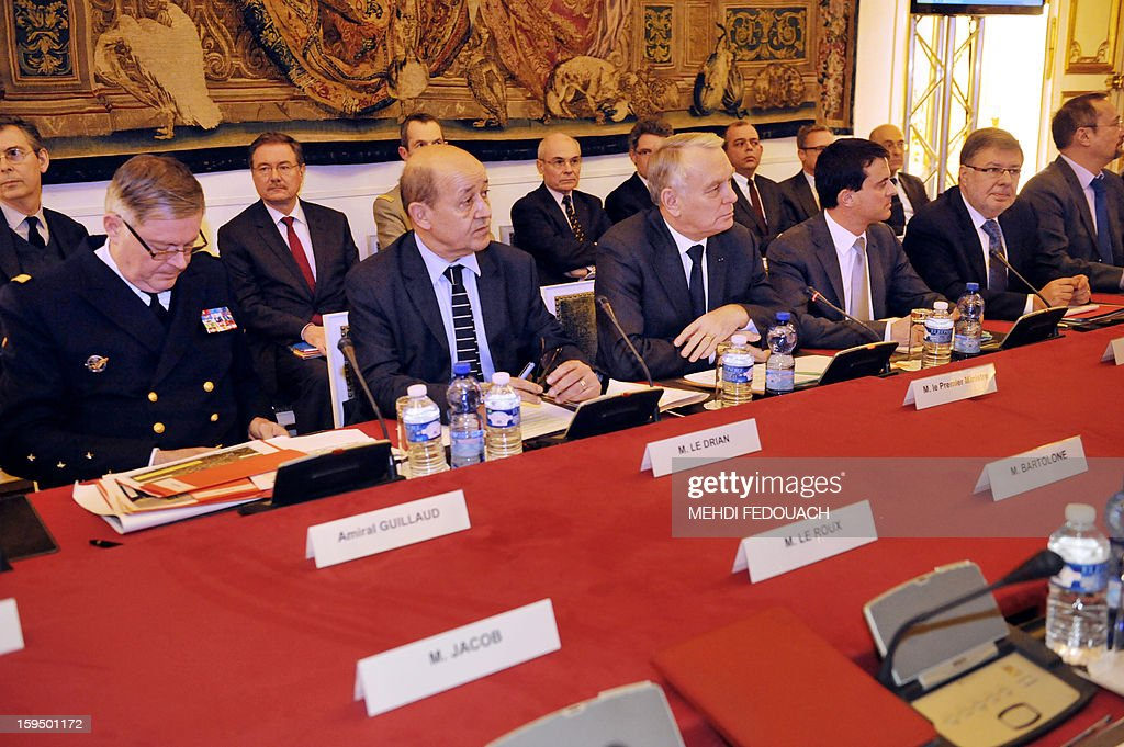 French Prime Minister Jean Marc Ayrault (3rdL) heads a meeting on January 14, 2013 at the Hotel Matignon in Paris, with (from L) Admiral Edouard Guillaud, France's armies chief of staff, French Defence Minister Jean-Yves Le Drian and French Interior Minister Manuel Valls (3rdR) to inform leaders of French political parties on France's military intervention in Mali. France launched its operation against Mali-based Islamists on a unilateral basis on January 11, but has since been offered logistical support by several NATO allies, including Belgium, Britain, Denmark, Germany and the United States.