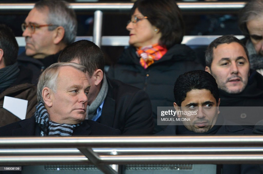 French Prime Minister Jean-Marc Ayrault (L) and chairman of the Paris Saint-Germain L1 football club, Nasser Al-Khelaifi (R) of Qatar attend the French L1 football match Paris Saint-Germain (PSG) vs Evian Thonon Gaillard (ETGFC) on December 8, 2012 at the Parc des Princes stadium in Paris.