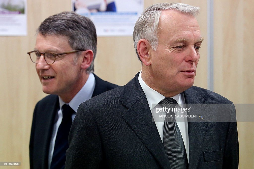 French Prime Minister Jean-Marc Ayrault (R) and French Education Minister Vincent Peillon visit the Colbert high school in Reims, eastern France, on February 14, 2013, before signing agreements for the 'Future Professional Jobs' (Emploi d'Avenir Professionnel, EAP in French).