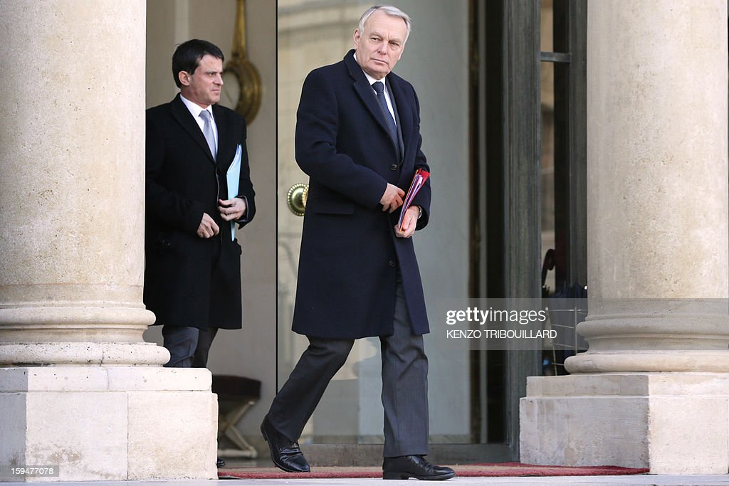 French Prime Minister Jean-Marc Ayrault (R) and French Interior minister Manuel Valls leave the Elysee Presidential palace in Paris, after a meeting with French President focused on the Malian situation on January 14, 2013. More than 60 Islamists were killed in their bases near the northern Malian city of Gao under intense bombardment by French air power, a security source and residents said today. 'France has attacked Islam. We will strike at the heart of France,' said Abou Dardar, a leader of Movement for Oneness and Jihad in West Africa, an offshoot of Al Qaeda in the Islamic Maghreb (AQIM), speaking to AFP by telephone.