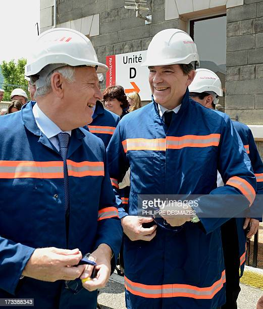 French Prime minister JeanMarc Ayrault and French Minister for Industrial Renewal and Food Industry Arnaud Montebourg share a joke as they arrive to...