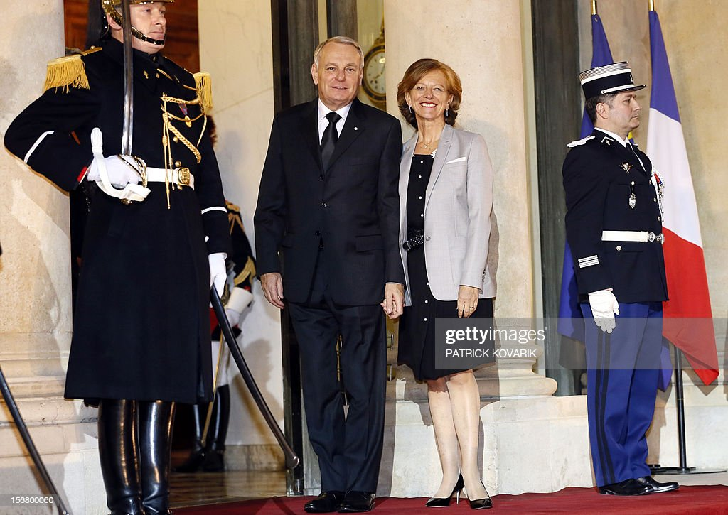 French Prime Minister Jean-Marc Ayrault (L) and his wife Brigitte arrive at the Elysee palace in Paris, before a state dinner as part of a two-day state visit of Italian President Giorgio Napolitano, on November 21, 2012. AFP PHOTO / PATRICK KOVARIK