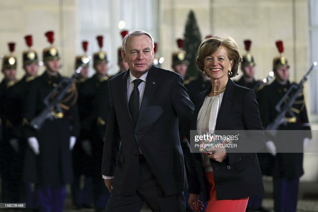 French Prime Minister Jean-Marc Ayrault (C) and his wife Brigitte Ayrault arrive at the Elysee Palace in Paris, on December 11, 2012, to attend a state dinner given in honour of Brazil's President. Brazilian President Dilma Roussef is on a two-day visit to France. AFP PHOTO / POOL / PHILIPPE WOJAZER