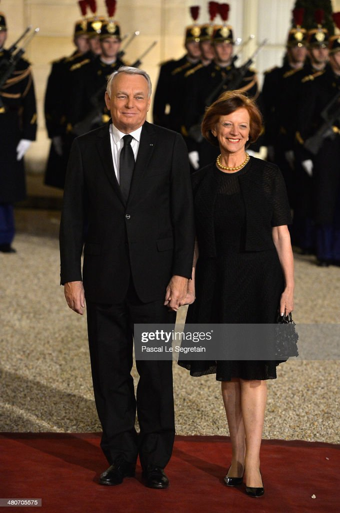 French Prime Minister <a gi-track='captionPersonalityLinkClicked' href=/galleries/search?phrase=Jean-Marc+Ayrault&family=editorial&specificpeople=551961 ng-click='$event.stopPropagation()'>Jean-Marc Ayrault</a> and his wife Brigitte Ayrault arrive at the Elysee Palace for an official dinner hosted by French President Francois Hollande as part of a two days State visit of the Chinese President Xi Jinping on March 26, 2014 in Paris, France.