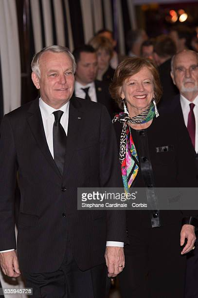 French Prime Minister JeanMarc Ayrault and his wife Brigitte Ayrault attend the premiere of 'Aimer Boire et Chanter' in Paris
