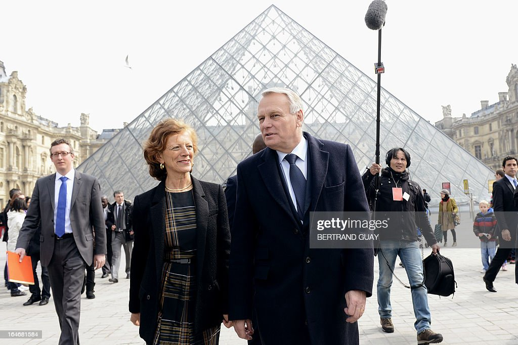 French Prime Minister Jean-Marc Ayrault and his wife Brigitte leave on March 26, 2013 after a visit of the exhibition 'De l'Allemagne, 1800-1939 - From Friedrich to Beckmann' at the Louvre museum in Paris .