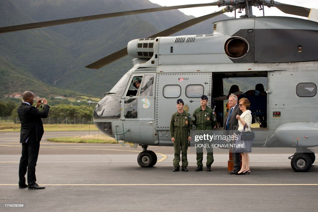 French Prime Minister Jean-Marc Ayrault (2nd L) and his wife Brigitte pose for a photo as they arrive in Koné on July 27, 2013. Ayrault is on a three-day visit to New Caledonia.