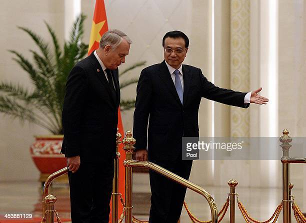 French Prime Minister JeanMarc Ayrault and the Chinese Premier Li Keqiang prepare to review an honour guard during his welcoming ceremony inside the...